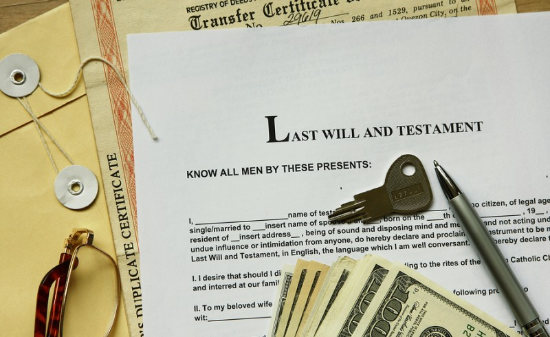 last will and testament with dollar certificate and key.